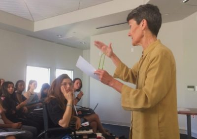 Professor lectures to students in a room