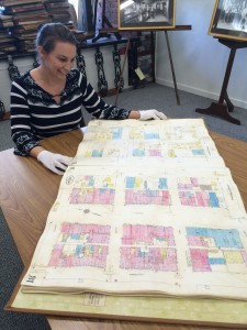 Christine Stokes displays a large document.