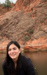 Maria del Pilar Ramirez Restrepo with water and mountain in the background