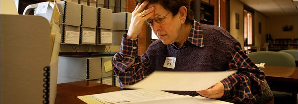 Photo of Professor Laura Kalman researching in the Reagan library archives