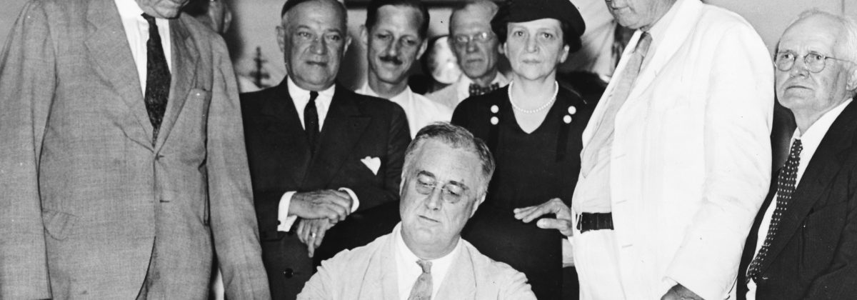 Roosevelt signs Social Security Bill