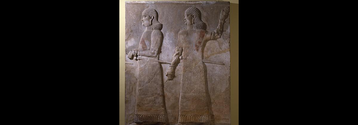 Two beardless Assyrian officials stone wall mural