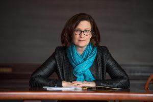 Bonnie Honig sitting at a table