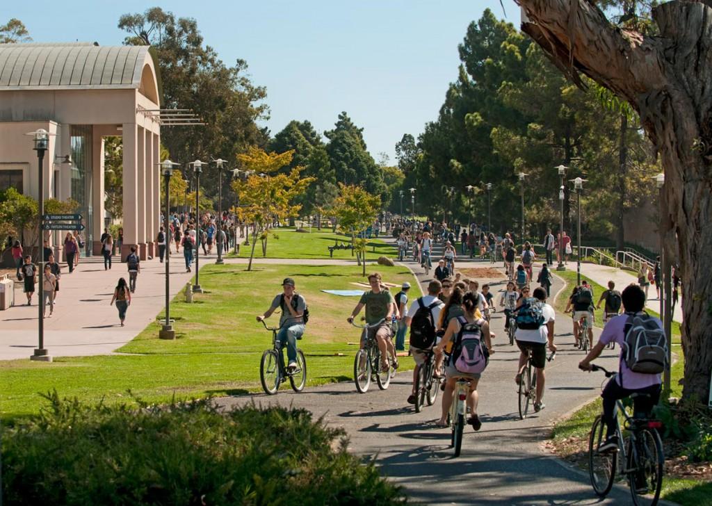 Photo of UCSB's bustling campus bike path near HSSB Building.