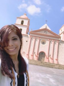 Veronica Andrade in front of mission